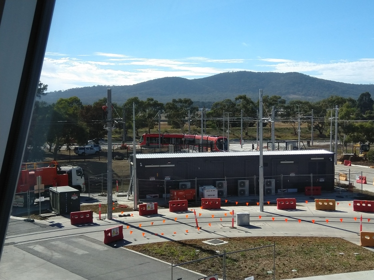 View from the control centre of the entrance and exit from the Mitchell light rail depot to Flemington Rd. Thats a large substation and in front of that is the track into and out of the workshop area.